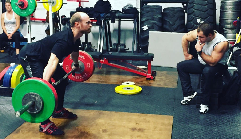 Snatch pull with a pause at the knee, with Coach Polovnikov counting to 6.